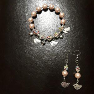 set bracciale elastico ed orecchini perle srass e metallo